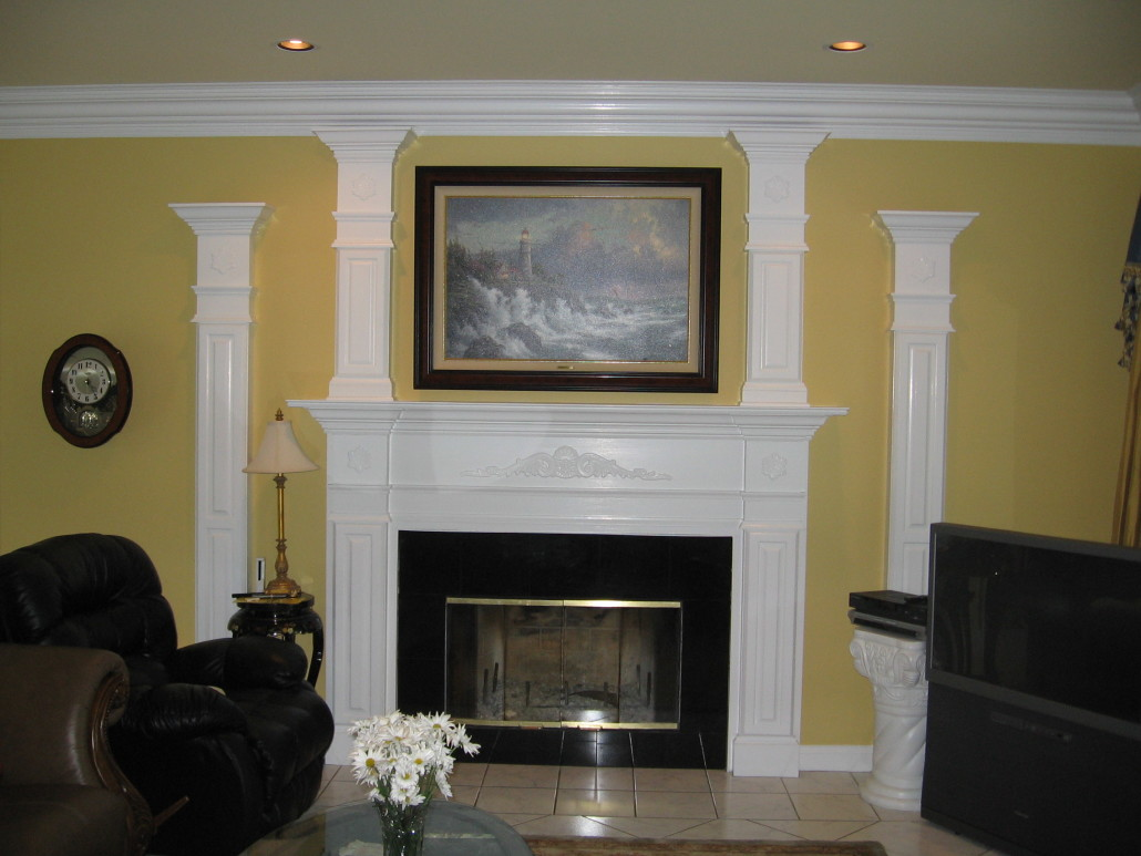 made two additional pilasters to match the existing pilasters on either side of the mantel